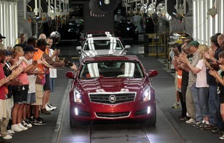 General Motors auto assembly workers celebrate during the official launch of the 2013 ATS Cadillac luxury vehicle at the Lansing Grand River Assembly Plant in Lansing, Michigan July 26, 2012. REUTERS/Rebecca Cook