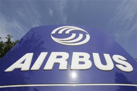 The Airbus company logo is pictured at the main entrance of the Airbus facility in the northern German city of Stade on October 11, 2006. REUTERS/Morris Mac Matzen