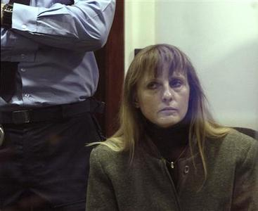 Michelle Martin, ex-wife of convicted child rapist Marc Dutroux, is seen during her trial in Arlon in this March 4, 2004 file photograph. A Belgian court is to rule on an appeal against the early release of Michelle Martin who has served 16 years of her 30-year sentence on August 28, 2012. REUTERS/Pool/Etienne Ansotte/Files
