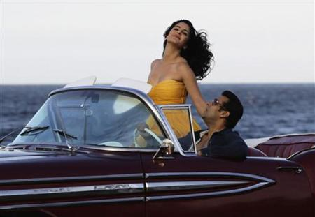 Bollywood star Salman Khan (R) drives with Katrina Kaif in a convertible car on Havana's seafront boulevard El Malecon February 15, 2012. REUTERS/Desmond Boylan/Files