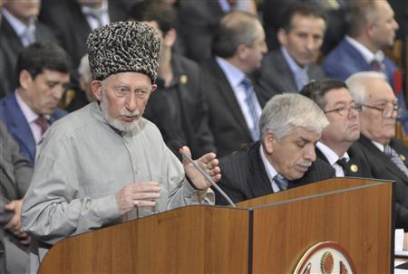 Said Atsayev (L), a leading Sufi Muslim cleric in the mostly Muslim region, addresses the audience during the Dagestan Peoples Congress in Makhachkala in this December 15, 2010 file photo. REUTERS/Sergei Rasulov/NewsTeam/Handout/Files