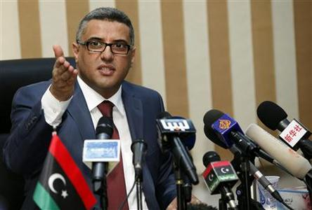 Libyan interim Interior Minister Fawzi Abdel A'al speaks at a news conference in Tripoli August 28, 2012. REUTERS/Ismail Zitouny