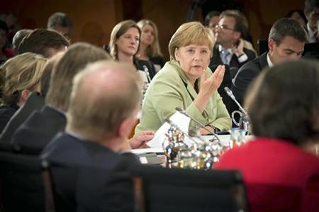 German Chancellor Angela Merkel speaks during the closing ceremony for the 'Dialogue about Germany's future' in the conference room of the Chancellery in Berlin, August 28, 2012. REUTERS/Bundesregierung/Guido Bergmann/Pool