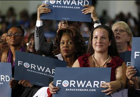 Supporters await U.S. President Barack Obama to speak at a campaign event at Hillsborough Community College in Tampa, Florida June 22, 2012. REUTERS/Kevin Lamarque