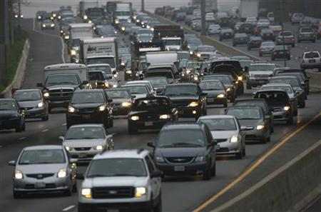 Morning commuter traffic moves slowly on the Washington Beltway, I-495, in Silver Spring, Maryland March 22, 2012. Picture taken March 22, 2012. REUTERS/Gary Cameron
