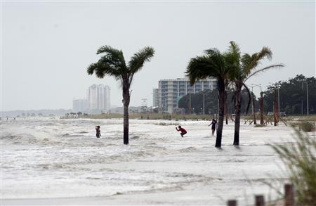 The storm surge washes up to Beach Blvd as Hurricane Isaac approaches Biloxi, Mississippi, August 28, 2012. REUTERS/Michael Spooneybarger