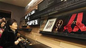 Park Geun-hye (front L) looks at relics pertaining to her mother and the late first lady Yuk Young-soo at an opening of the Park Chung Hee Memorial-Library in Seoul in this February 21, 2012 file picture. REUTERS/Park Sang-hun/Newsis