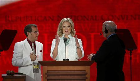 Ann Romney, wife of Republican presidential candidate Mitt Romney, talks with convention officials as she tours the stage before the second session of the Republican National Convention in Tampa, Florida, August 28, 2012 REUTERS/Mike Segar