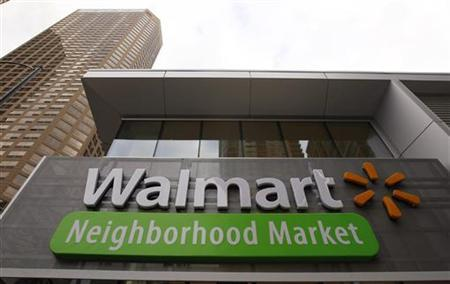 A Walmart Neighborhood Market sign is seen outside a newly opened store in Chicago September 21, 2011. REUTERS/Jim Young