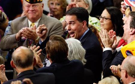 Wisconsin Governor Scott Walker pumps his fist as he announces his state's vote totals after Republican presidential nominee Mitt Romney secured the necessary delegate votes to put him over the top and win the Republican presidential nomination during the second session of the Republican National Convention in Tampa, Florida, August 28, 2012 REUTERS/Mike Segar