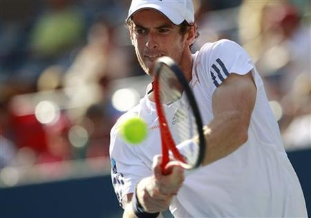 Britain's Andy Murray hits a return to Alex Bogomolov Jr. of Russia during their men's singles match at the U.S. Open tennis tournament in New York August 27, 2012. REUTERS/Kevin Lamarque