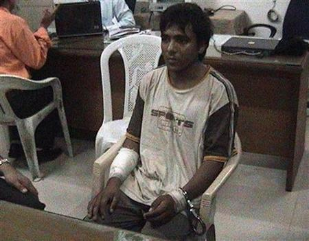 Mohammed Ajmal Kasab, the lone surviving suspected gunman in the 2008 Mumbai attacks, is under police custody at an undisclosed location in this undated video grab from footage shown on CNN IBN television channel February 3, 2009. REUTERS/CNN IBN/Handout/Files