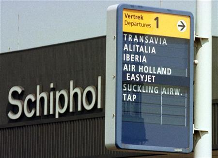 Sign shows direction to the departure of Alitalia and Iberia flights at Amsterdam Schiphol airport on May 12, 1998. REUTERS/Str Old