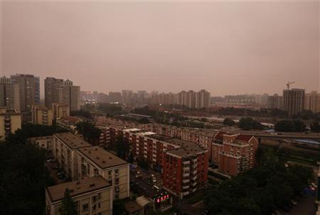 A general view shows Beijing skyline on a hazy day July 26, 2012. Smoke from factories and heating plants, winds blowing in from the Gobi Desert and fumes from millions of vehicles can combine to blanket the city in this pungent shroud for days. REUTERS/Jason Lee