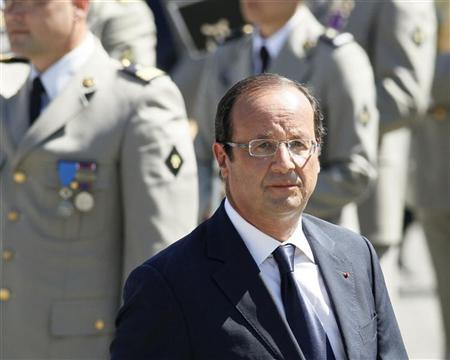 France's President Francois Hollande leaves after he paid homage to Major Franck Bouzet, who was killed in Afghanistan, at the 93rd regiment of Artillery in Varces, French Alps, August 11, 2012. REUTERS/Robert Pratta