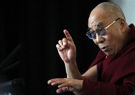 Tibet's exiled spiritual leader the Dalai Lama answers questions at a news conference in Manchester, northern England in this June 15, 2012 file photo. REUTERS/Phil Noble/Files