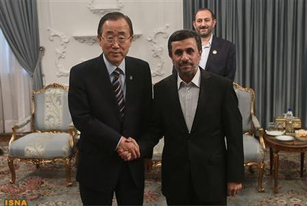 United Nations Secretary-General Ban Ki-moon (L) poses for a photo with Iran's President Mahmoud Ahmadinejad (R) upon his arrival for the 16th summit of the Non-Aligned Movement in Tehran, August 29, 2012. REUTERS/Arash Khamooshi/ISNA/Handout