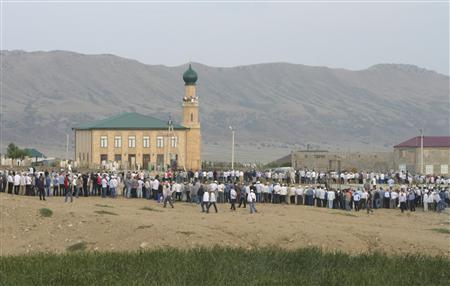 People gather before the funeral of Said Atsayev, a leading Sufi Muslim cleric, in the village of Chirkey in the Republic of Dagestan, August 28, 2012.REUTERS/Abdula Magomedov/NewsTeam/Handout
