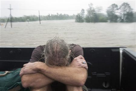 A resident of Plaquemines Parish who was rescued from his flooded home sits in the back of a pickup truck during Hurricane Isaac in Braithwaite, Louisiana August 29, 2012. REUTERS/Lee Celano