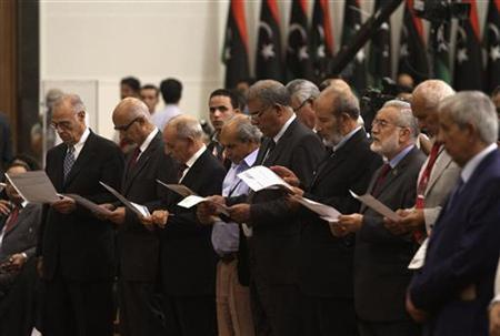 Members of the national congress take an oath during the handover ceremony of power from the National Transitional Council (NTC) in Tripoli August 8, 2012. REUTERS/Esam Al-Fetori
