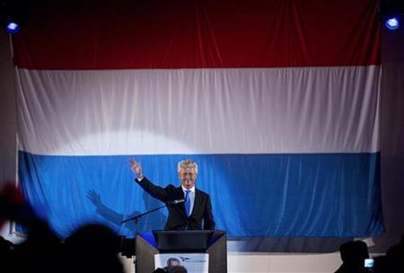 PVV Leader Geert Wilders waves to his party members at the start of a Freedom Party meeting in Rotterdam August 24, 2012. REUTERS/Michael Kooren