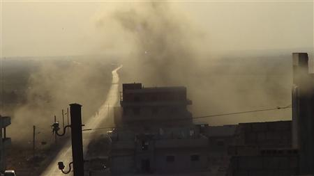 Smoke rises after a Syrian Air Force fighter jet fired missiles at Binsh near Idlib August 29, 2012. REUTERS/Shaam News Network/Handout