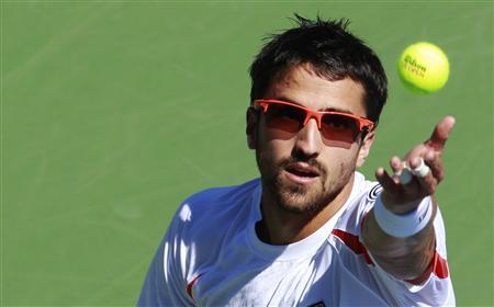Janko Tipsarevic of Serbia serves to Guillaume Rufin of France during their men's singles match at the U.S. Open tennis tournament in New York August 29, 2012. REUTERS/Kevin Lamarque