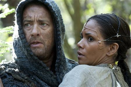 Actors Tom Hanks (L) and Halle Berry are shown in a scene from the upcoming Warner Bros film ''Cloud Atlas'' in this publicity photo released to Reuters August 29, 2012. REUTERS/Jay Maidment/Warner Bros Pictures/Handout