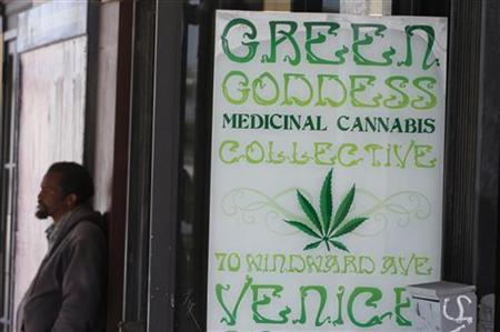 A man stands in front of a medical marijuana dispensary in Los Angeles, California, July 24, 2012. REUTERS/Jonathan Alcorn