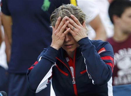 Kim Clijsters of Belgium reacts after her defeat to Laura Robson of Britain in their women's singles match at the U.S. Open tennis tournament in New York August 29, 2012. REUTERS/Jessica Rinaldi