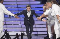 "Host Ryan Seacrest arrives on the stage during the 11th season finale of ""American Idol"" in Los Angeles, California, May 23, 2012. REUTERS/Mario Anzuoni"