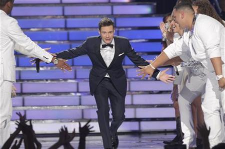 Host Ryan Seacrest arrives on the stage during the 11th season finale of ''American Idol'' in Los Angeles, California, May 23, 2012. REUTERS/Mario Anzuoni