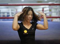 India's boxer MC Mary Kom gestures during an interview with Reuters at Balewadi Stadium in Pune, about 190 km (118 miles) from Mumbai, March 12, 2012. REUTERS/Danish Siddiqui