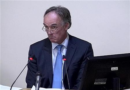 A still image from broadcast footage shows former News of the World lawyer Tom Crone speaking at the Leveson Inquiry at the High Court in central London December 13, 2011. REUTERS/POOL via Reuters TV