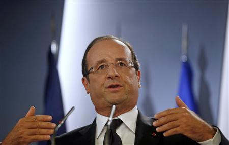 France's President Francois Hollande gestures during a joint news conference with Spain's Prime Minister Mariano Rajoy (not pictured) after their meeting at the Moncloa Palace in Madrid August 30, 2012. REUTERS/Juan Medina