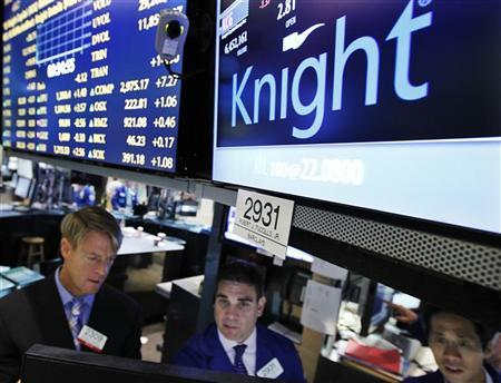 Barclays Capital specialists work at the post that trades Knight Capital on the floor of the New York Stock Exchange, August 6, 2012. REUTERS/Brendan McDermid