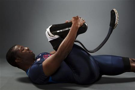 Paralympic sprinter Jerome Singleton stretches while posing for a portrait during the 2012 U.S. Olympic Team Media Summit in Dallas, Texas May 15, 2012. REUTERS/Lucas Jackson