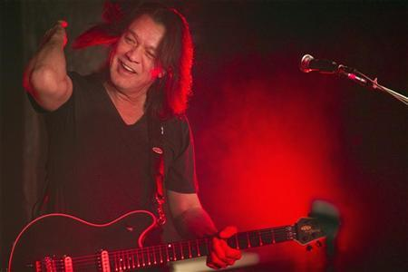 Guitarist Eddie Van Halen performs during a private Valen Halen show to announce the band's upcoming tour at Cafe Wha? in New York January 5, 2012. REUTERS/Lucas Jackson