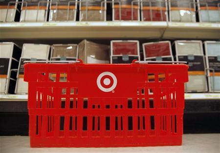 A shopping basket rests on the floor of a Target store in Dallas, Texas September 3, 2009. REUTERS/Jessica Rinaldi