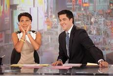 "ABC newswoman Robin Roberts (L) makes her final appearance on ABC's ""Good Morning America"" August 30, 2012 before taking medical leave as she is shown with fellow cast member Josh Elliott in this publicity photograph released to Reuters. REUTERS/Fred Lee/Handout"