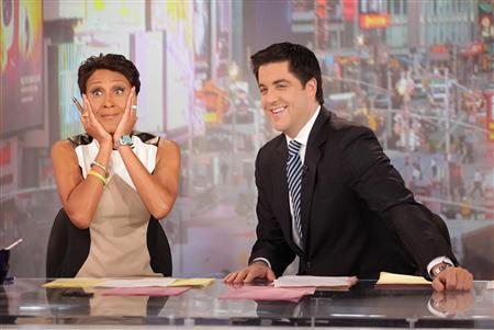 ABC newswoman Robin Roberts (L) makes her final appearance on ABC's ''Good Morning America'' August 30, 2012 before taking medical leave as she is shown with fellow cast member Josh Elliott in this publicity photograph released to Reuters. REUTERS/Fred Lee/Handout