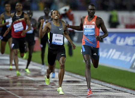 Ethiopia's Mohammed Aman (C) celebrates as he won the men's 800m race in front of David Rudisha of Kenya (R) during the Weltklasse Diamond League meeting in Zurich August 30, 2012. REUTERS/Ruben Sprich