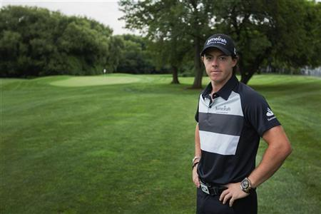 Golfer Rory McIlroy of Northern Ireland poses for a portrait in New York August 20, 2012. REUTERS/Lucas Jackson
