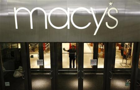 A worker cleans windows at a Macy's store in Arlington, VA, February 21, 2012. REUTERS/Kevin Lamarque