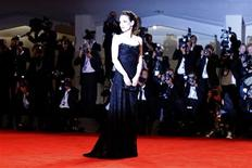 """U.S. actress Winona Ryder poses during the red carpet for the movie """"Iceman"""" at the 69th Venice Film Festival August 30, 2012. REUTERS/Tony Gentile"""