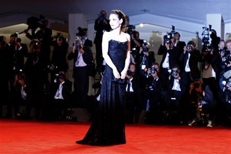U.S. actress Winona Ryder poses during the red carpet for the movie ''Iceman'' at the 69th Venice Film Festival August 30, 2012. REUTERS/Tony Gentile