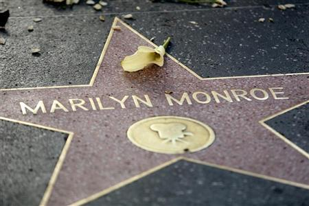 A flower lays atop the Hollywood Walk of Fame star for the late actress Marilyn Monroe in Hollywood August 5, 2012. REUTERS/Krista Kennell