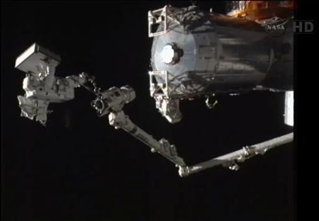 In this still image taken from video, Japan Aerospace Exploration Agency Flight Engineer Akihiko Hoshide takes a ride on the end of the space arm during a spacewalk outside the International Space Station, August 30, 2012. REUTERS/NASA/Handout