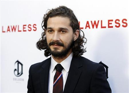 Cast member Shia LaBeouf poses at the premiere of the film ''Lawless'' in Los Angeles August 22, 2012. REUTERS/Danny Moloshok