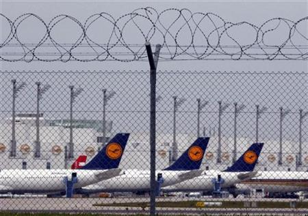 Lufthansa planes stand on the tarmac at Munich's international airport August 30, 2012. REUTERS/Michael Dalder
